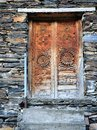 Wooden door vintage with ornament on stone wall background georgia Stock Photos