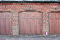 Wooden doors large in a brick building Stock Image