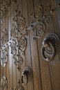Wooden doors with metalwork. Stock Photo