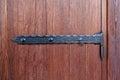Wooden doors and vintage metal hinges Royalty Free Stock Photo