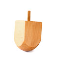 Wooden dreidel (spinning top) for hanukkah jewish holiday isolated on white. Royalty Free Stock Photo