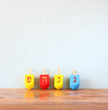 Wooden dreidels for hanukkah on wooden table Royalty Free Stock Photo
