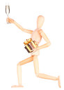 Wooden Dummy with champagne holding gift Royalty Free Stock Photo
