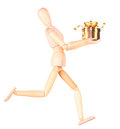 Wooden Dummy holding gift with ribbon Royalty Free Stock Photo