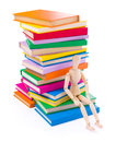 Wooden dummy puppet sitting on books Royalty Free Stock Photo