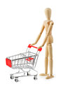 stock image of  Wooden dummy with shopping cart on white background