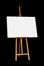 Wooden Easel with Blank Painting Canvas Isolated on Black Backgr Royalty Free Stock Photo