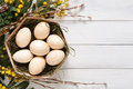 Wooden easter eggs on white wood background