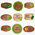 Wooden eco labels bages stickers collection with green leaves and grass bio and natural product natural gluten free organic Royalty Free Stock Photo