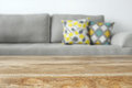 Wooden empty table in front of Living room sofa interior Royalty Free Stock Photo