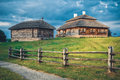 Wooden ethnic houses on rural landscape, Kossovo, Brest region, Belarus. Royalty Free Stock Photo