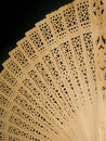 Wooden fan woman on black background Royalty Free Stock Photos
