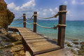 Wooden fence beach thailand the the blue sky cloud beautiful the rocky seashore Royalty Free Stock Image