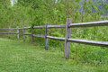 Wooden fence a beautiful old next to a grass meadow Stock Photography