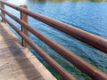 Wooden fence on a bridge over water Royalty Free Stock Image