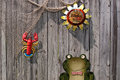 Wooden fence decorated for summer a with lobster frog and sunflower Royalty Free Stock Photography