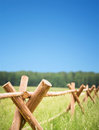 Wooden fence in field encloses farmer economy Royalty Free Stock Photography