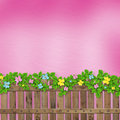 Wooden fence with a flower garland Stock Image