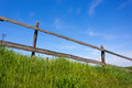 Wooden fence on grassland with blue sky Royalty Free Stock Image