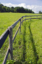 Wooden fence on grassland in summer farm Royalty Free Stock Photo