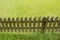 Wooden fence and green grass Stock Photography