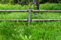 Wooden fence with green grass all around Royalty Free Stock Photo