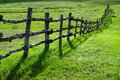 Wooden fence on green meadow Royalty Free Stock Image