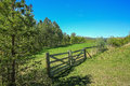 Wooden fence at the meadow Royalty Free Stock Photo