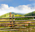 Wooden fence on mountain meadow Royalty Free Stock Photo