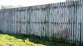 Wooden fence needs to be painted Stock Image