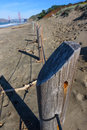 Wooden fence post on beach near Golden Gate Bridge Royalty Free Stock Photo
