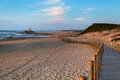 Wooden fence on sand dunes at Miramar beach on the Atlantic coast of Portugal. Nature. Royalty Free Stock Photo