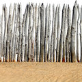 Wooden Fence on the Sand Royalty Free Stock Photo