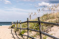 Wooden Fence on Sandy Pathway to Beach at Sandbridge Royalty Free Stock Photo