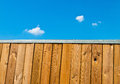 Wooden fence with sky a blue and clouds Royalty Free Stock Image