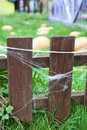 Wooden fence with web on planks Royalty Free Stock Image