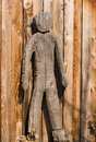 Wooden figure a made of wood before a wall Royalty Free Stock Image