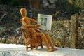 Wooden Figure Sitting On Patio...