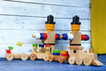 Wooden figures and freight train and wagons Royalty Free Stock Photo