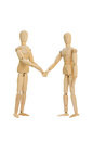 Wooden figures shake hands Royalty Free Stock Photo