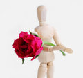 Wooden figurine man holding rose Royalty Free Stock Photo