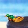 Wooden figurines mandarin duck colorful Stock Photo