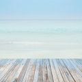 Wooden floor with beautiful ocean and blue sky retro pastel sce Royalty Free Stock Photo