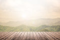 Wooden floor with mountain landscape blurred background Royalty Free Stock Photo