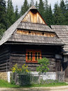Wooden folk house in zuberec museum summer view of rare with fence and forest background this belongs to open air of orava village Royalty Free Stock Image
