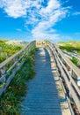 Wooden footbridge on the beach Royalty Free Stock Photo