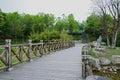 Wooden footbridge in verdant spring Royalty Free Stock Photo
