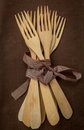 Wooden forks many tied brown ribbon Stock Photography