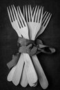 Wooden forks many tied brown ribbon Royalty Free Stock Image