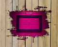 Wooden frame above pink brick wall Stock Images